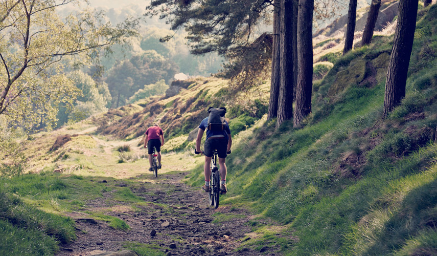 Best UK Bike Rides, guys cycling along a contry side path